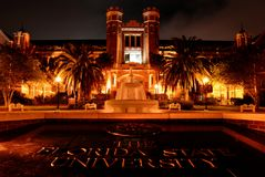Westcott Building at Florida State University. Florida State University Plaque with fountain in front of the Westcott Building, lit up at night royalty free stock image