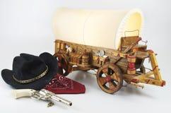 Westen tema med den dolda vagnen Arkivfoton