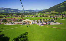 Westendorf village in the Alps mountains , cable lift station. WESTENDORF, TIROL, AUSTRIA - AUGUST21, 2016. Westendorf village in the Alps mountains , cable lift Royalty Free Stock Photo
