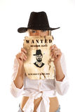 A wester girl in a hat holding a wanted sign Royalty Free Stock Images
