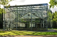 Westerbork Transit Camp Grounds: Gemmekers House. Camp Commander Gemmekers House of Westerbork Transit Camp, The Netherlands, now covered by a Steel and Glass Royalty Free Stock Photo
