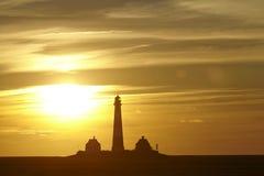 Westerhever (Германия) - маяк на заходе солнца Стоковая Фотография
