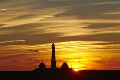 Westerhever (Duitsland) - Vuurtoren bij zonsondergang Royalty-vrije Stock Foto's