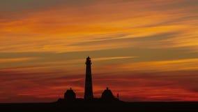 Westerhever - faro en la puesta del sol (minuto del lapso de tiempo 90 a 21 s) almacen de metraje de vídeo