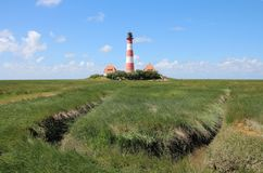 The Westerhever Lighthouse at the coast of Schleswig-Holstein in Germany stock photos