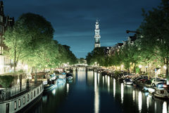 Westerkerk church tower at canal in Amsterdam Stock Image