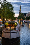 Westerkerk and Houseboat at Sunset in Amsterdam Stock Photo