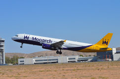 Departure From Alicante Airport - Monarch Passenger Flight Aircraft. A Monarch airlines plane departs in the less usual westerly direction from El Altet airport stock image