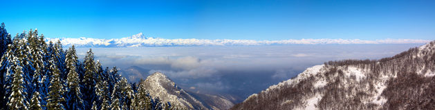 Western Alps and Monviso. From Prato Nevoso,north west Italy  - during winter, under the clouds, the  Langa Valley Stock Photo