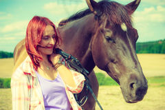 Western animal lover woman hugging horse Royalty Free Stock Image