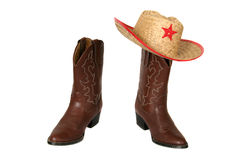 Western boots with cowboy hat. Brown western boots with straw cowboy hat stock images