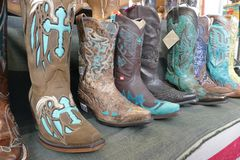Western boots on sale in a fair north american theme stock images