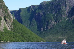 Western Brook Pond Fjord in Gros Morne. A tour boat on Western Brook Pond in Gros Morne National Park, Newfoundland, Canada Stock Image