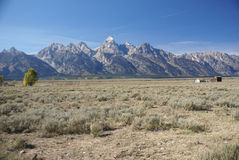 Western buildings with Tetons in background. Antelope Flats,  Grand Teton National Park, Wyoming Stock Photo