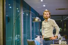 Western business man standing in office at night royalty free stock photos