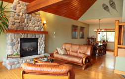 Western Charm. A west coast living and dining room with a river rock fireplace Stock Photo