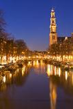 The Western Church and a canal in Amsterdam at night Stock Photography