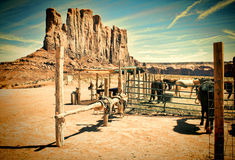 Western Corral and Vintage Landscape. A vintage style image of a horse corral with horses and a large rock formation in Arizona Royalty Free Stock Image