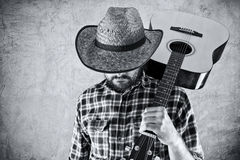 Western country cowboy musician with guitar. Black and white portrait Stock Photo