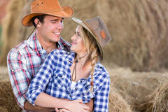 Western couple barn. Loving young american western couple hugging in barn Stock Image