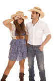 Western couple with cowboy hats Royalty Free Stock Image