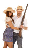 Western couple gun hats both looking Royalty Free Stock Photography