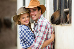 Western couple stables Royalty Free Stock Photo