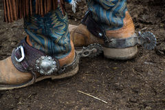 Western cowboy boots and silver spurs. For riding horses stock images