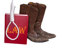 Western Cowboy Law, Justice, Hangman Noose, Rope. Concept for western frontier cowboy justice, law and order, and the old west. Law book, cowboy boots, hangman Royalty Free Stock Photo