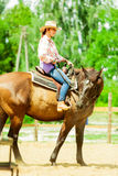 Western cowgirl woman riding horse. Sport activity Royalty Free Stock Photos