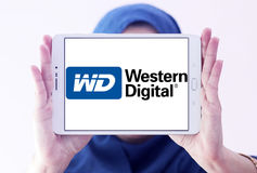 Western Digital Corporation logo. Logo of Western Digital Corporation on samsung tablet holded by arab muslim woman. Western Digital Corporation is an American royalty free stock photos
