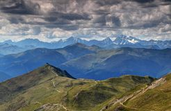 Western end of Carnic Alps main ridge with snowy High Tauern Stock Image