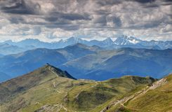 Western end of Carnic Alps main ridge with snowy High Tauern royalty free stock image