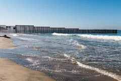 Western End of San Diego-Tijuana International Border Wall in Pacific Ocean. The western end of the international border wall in the Pacific ocean, as it Stock Image