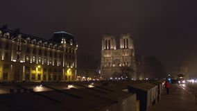 Western facade of famous Notre Dame de Paris cathedral illuminated at night. Popular touristic destination in France. 4K. Western facade of famous Notre Dame de stock video footage