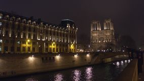 The western facade of famous Notre Dame de Paris cathedral illuminated at night. Popular touristic destination. 4K video. The western facade of famous Notre Dame stock footage