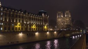The western facade of famous Notre Dame de Paris cathedral illuminated at night. Popular touristic destination Royalty Free Stock Photos