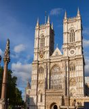 Westminster Abbey and Column London UK. Western facade of Westminster Abbey with Westminster Column, City of Westminster, Central Area of Greater London, UK royalty free stock image