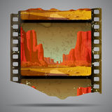 Western film piece. Fragment of vintage western film strip with big canyon. There is in addition a vector format (EPS 10 Stock Images