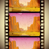 Western film strip. Raster version of vector image of the vintage western film strip with big canyon - vertical seamless pattern background ((contain the Stock Photos