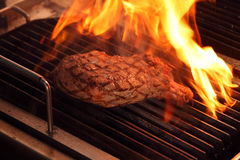 Western Food. A pieces of beef cooking on a grill oven Stock Photos