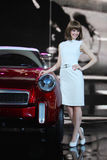 Western girl in auto show Royalty Free Stock Image
