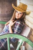 Western girl. Cowgirl with hat in the western town Royalty Free Stock Photography