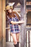 Western girl. Cowgirl with  hat in the western town Royalty Free Stock Photo