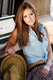 Western girl. Cowgirl with  hat in the western town Stock Images
