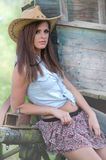 Western girl. Cowgirl with  hat in the western town Stock Photos
