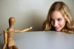 Western girl with a mannequin Stock Photography