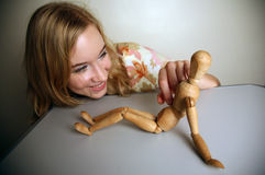 Western girl with a mannequin Royalty Free Stock Images