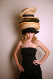 Western girl wearing many hats Royalty Free Stock Photos