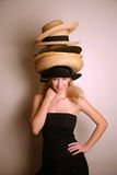 Western girl wearing many hats Royalty Free Stock Image